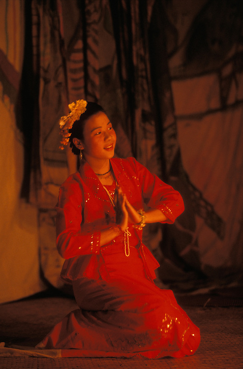 An actress and singer performs in a temple yard during Poy Sang Long, the yearly ordination of novice monks, Mae Hong Son, Thailand. She belongs to a traditional Shan theatre group.