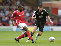 Photo: Leigh Quinnell.<br /> Nottingham Forest v Bristol City. Coca Cola League 1. 21/10/2006. Forests Wes Morgan gets to the ball before Bristol Citys Phil Jevons.