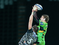 Northampton Saints' Jamie Gibson claims the lineout despite pressure from Ospreys' Alun Wyn Jones<br /> <br /> Photographer Simon King/Replay Images<br /> <br /> EPCR Champions Cup Round 4 - Ospreys v Northampton Saints - Sunday 17th December 2017 - Parc y Scarlets - Llanelli<br /> <br /> World Copyright © 2017 Replay Images. All rights reserved. info@replayimages.co.uk - www.replayimages.co.uk