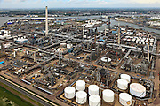 Nederland, Zuid-Holland, Rotterdam, 22-05-2011;.Botlek. De petrochemische industrie van olieraffinaderij Shell Pernis met olieopslag. Rechts boven in beeld de Eerste Petroleumhaven. Skyline Rotterdam. , De Nieuwe Waterweg boven in beeld..Botlek. The Petrochemical industry with oil storage. To the right  the Eerste Petroleumhaven (First Petroleum Harbour), The Nieuwe Waterweg (top).    . luchtfoto (toeslag), aerial photo (additional fee required).foto/photo Siebe Swart