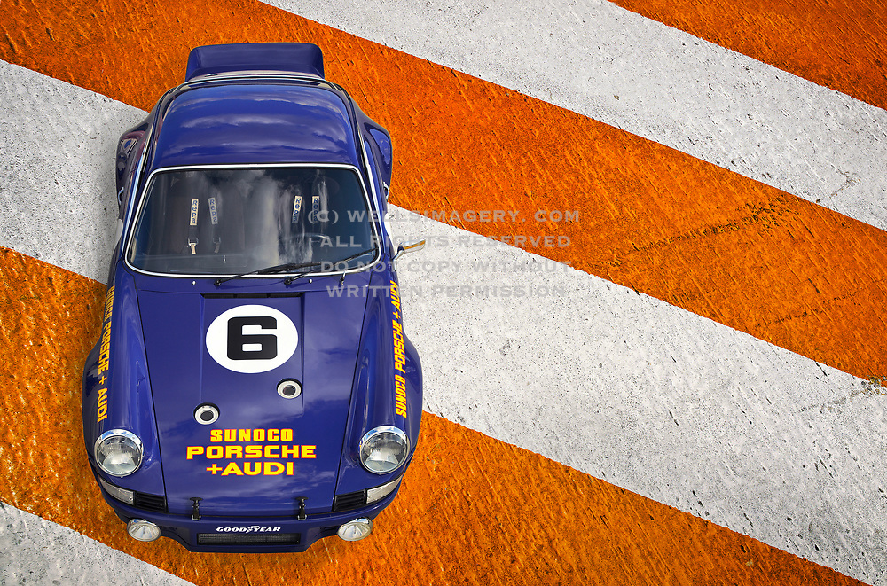 Automotive Car Photographer and Videographer Randy Wells, Image of a 1973 Sunoco RSR tribute car on orange and white stripes, Porsche 911 RSR, property released