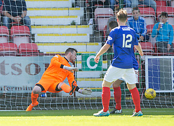 Dunfermline's Faissal El Bahktaoui scoried their first goal past Cowdenbeath's keeper Michael Andrews. <br /> Dunfermline 5 v 1 Cowdenbeath, Scottish League Cup game played today at East End Park.