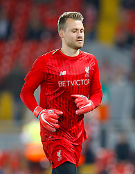Liverpool goalkeeper Simon Mignolet warms up ahead of the Carabao Cup, Third Round match at Anfield, Liverpool.