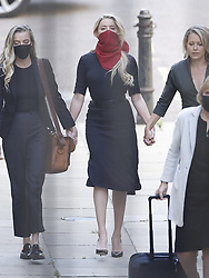 © Licensed to London News Pictures. 07/07/2020. London, UK. US actor Amber Heard (C) arrives at The High Court in Central London. Johnny Depp's libel trial against The Sun newspaper is due to take place over the next three weeks over allegations he was violent and abusive towards his ex-wife Amber Heard. Photo credit: Peter Macdiarmid/LNP