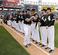 CHICAGO - APRIL 07:  Phil Humber #41 (L) is greeted by Mark Buehrle #56 of the Chicago White Sox during Opening Day ceremonies prior to the game between the Chicago White Sox and Tampa Bay Rays on April 07, 2011 at U.S. Cellular Field in Chicago, Illinois.  The White Sox defeated the Rays 5-1.  (Photo by Ron Vesely)  Subject: Mark Buehrle;Phil Humber