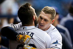 August 24, 2017 - St. Petersburg, Florida, U.S. - WILL VRAGOVIC       Times.Tampa Bay Rays right fielder Steven Souza Jr. (20) hugs Tampa Bay Rays left fielder Corey Dickerson (10) after his solo home run in the eighth inning of the game between the Toronto Blue Jays and the Tampa Bay Rays at Tropicana Field in St. Petersburg, Fla. on Thursday, Aug. 24, 2017. (Credit Image: © Will Vragovic/Tampa Bay Times via ZUMA Wire)