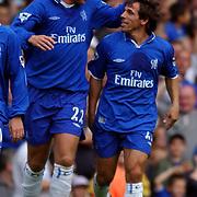 Chelsea goalscorers Eidur Gudjohnsen and Gianfranco Zola celebrate