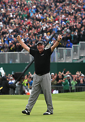 File photo dated 17-07-2011 of Northern Ireland's Darren Clarke celebrates after sinking his putt on the 18th to win the 2011 Open Chapionship