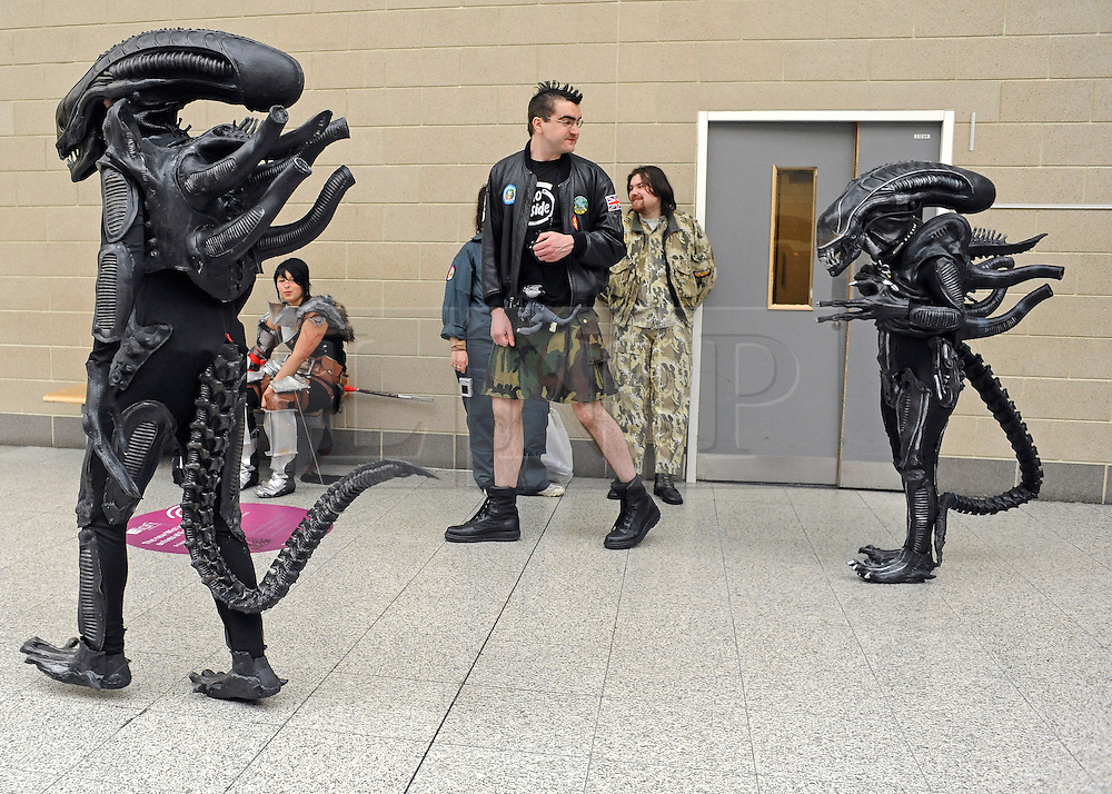 © Licensed to London News Pictures. 30/10/2011. London, UK. Characters from the film Alien patrol the corridors of the centre. The London Comic Con today, 30th October 2011 as fans of comics, computer games and Sci-Fi movies,  dress up as some of their favourite characters. The London MCM Expo takes place on 28-30th October 2011 at the excel centre in London.  Photo: Stephen Simpson/LNP