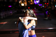 Second place winner Sarah Crouch, left, and third place winner Georgia Porter, right, both of Flagstaff, hug after crossing the finish line at the women's half marathon run of the Rock 'n' Roll Las Vegas Marathon along the Strip near The Mirage in Las Vegas, Sunday, Nov. 12, 2017. (Joel Angel Juárez / Las Vegas Review-Journal)