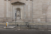 Statue of Sir John Soane at the Bank of England overlooking a deserted street during the coronavirus pandemic on the 10th May 2020 in London, United Kingdom. Sir John Soane designed the Bank of England in 1793.