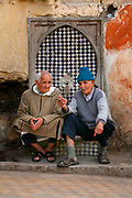Early Monday morning, May 28, 2007, two men gather at one of several hundred fountains that make Fes, Morocco so unique. This particular fountain is located near the entrance to Bab Sammarine in the Fes Al- Jedid or Jewish quarter. Water is a symbol of life and power here in Fes. Water supplies have been becoming more scarce over the years, a troubling sign for people here.  (PHOTO BY TIMOTHY D. BURDICK)