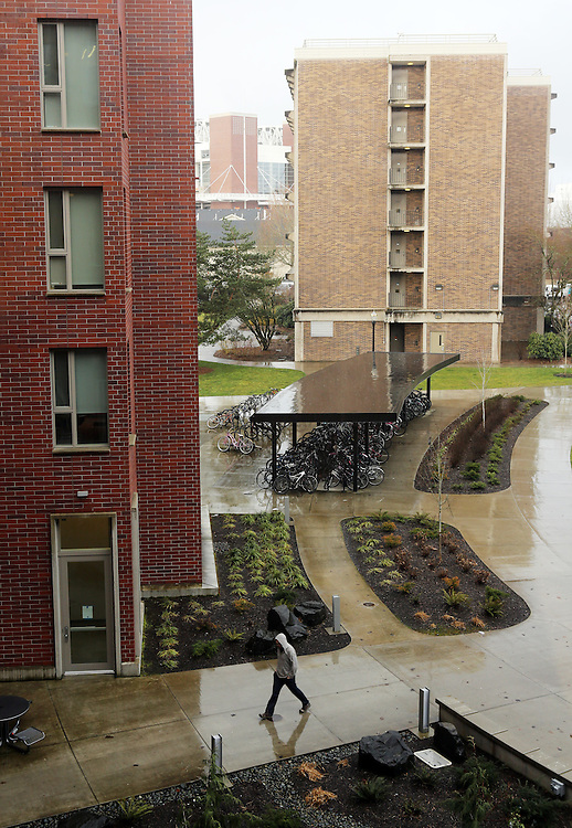 An unusual effort to assimilate foreign students and prepare them for attending an American university is run jointly by a private company, INTO, and Oregon State University in Corvallis, Ore. The students live and study in a campus building, the International Living-Learning Center.