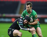 Connacht's Matt Healy is tackled by Ospreys' Sam Davies.<br /> <br /> Guinness Pro12 rugby match, Ospreys v Connacht rugby at the Liberty Stadium in Swansea, South Wales on Saturday 7th January 2017.<br /> pic by Craig Thomas, Andrew Orchard sports photography.