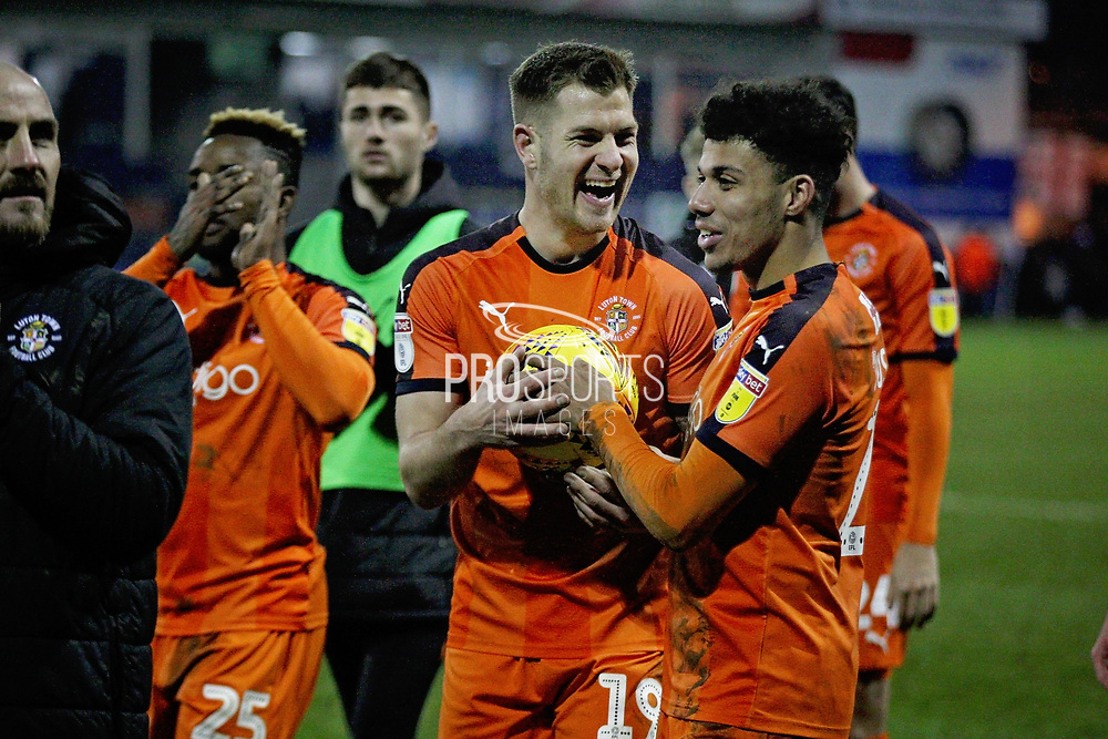 Hat trick hero Luton Town FC forward James Collins (19) fights for the match ball after the EFL Sky Bet League 1 match between Luton Town and Peterborough United at Kenilworth Road, Luton, England on 19 January 2019.