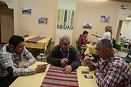 Syrian friends sitting in Sbidag restaurant, recently opened for the newly arrived Syrian community. Left to right; George, Harout and Jacob, all from Aleppo, Syria.