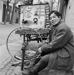 Bicycle repairman in a hutong or alley in Beijing China