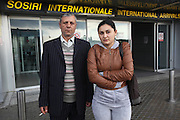 Isabella Baboi and Niculae Nila, both Romanian Roma Gypsies, were arrested on separately for stealing. They were expelled by the French authorities, deported from Paris aboard a plane to Bucharest 25th September 2010. Bucharest airport, Bucharest, Romania..Roma Gypsies left India 1000 years ago. Often nomadic. A collection of tribes with their own languages and culture, pushed by the Ottoman empire towards Europe, used and sold as mercenaries, slaves, prostitutes. They endured 500 years of slavery until mid 19th century. A million were killed in the holocaust. Hundreds of thousands exiled and refugees from kosovo. Many Eastern Europe Roma come to the west seeking a better life. They are shunned, marginalized, excluded. Both indigenous and foriegn Roma, whether European citizens or not, lack the opportunities of others, living on the periphery, in the brunt of racism, often deported back to their countries of origin.
