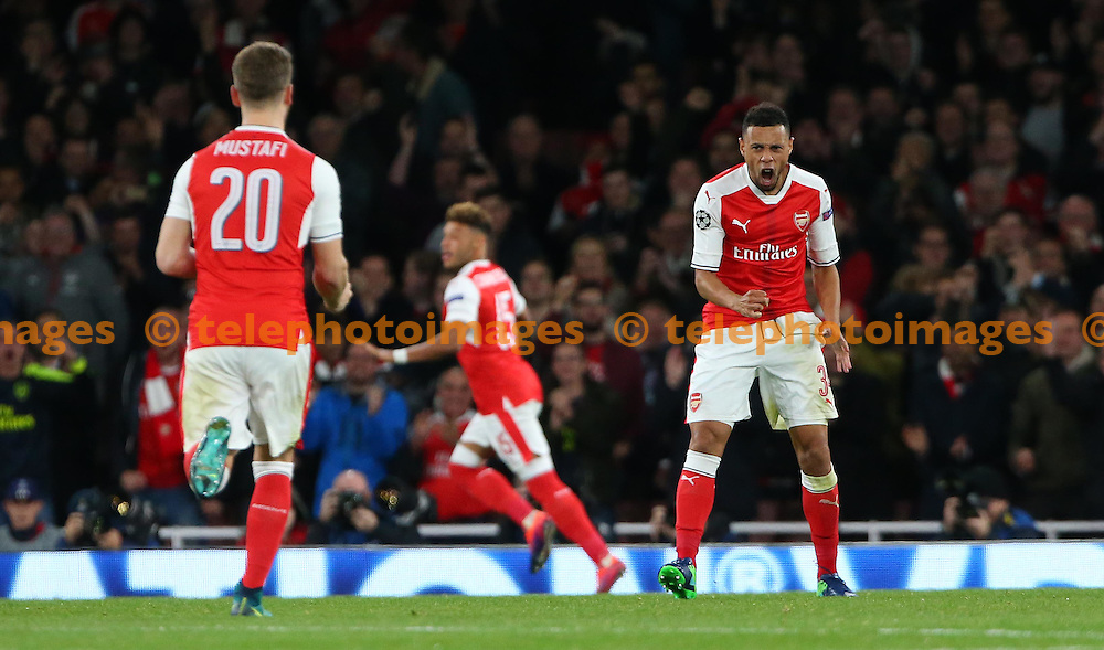 Arsenal's Francis Coquelin celebrates Alex Oxlade-Chamberlain's goal during the UEFA Champions League match between Arsenal and Ludogorets Razgrad at the Emirates Stadium in London. October 19, 2016.<br /> James Boardman / Telephoto Images<br /> +44 7967 642437