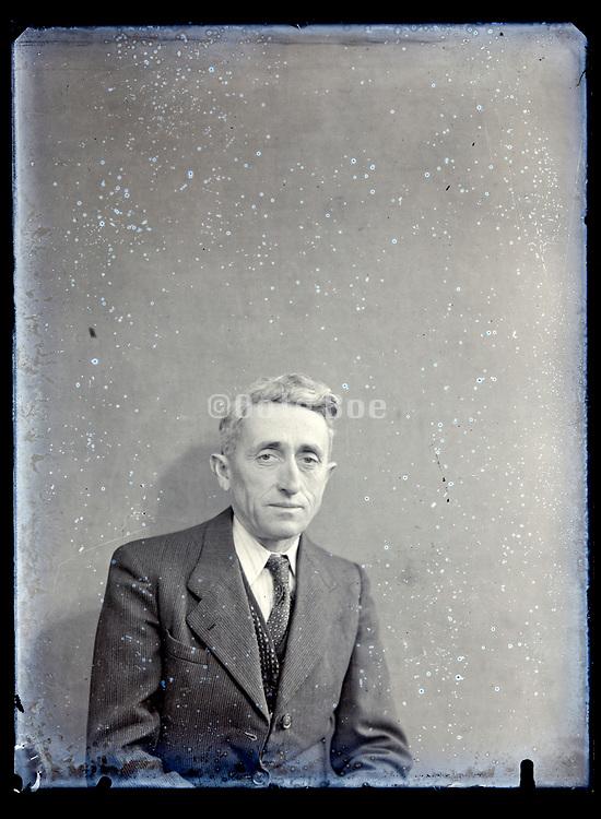 vintage portrait of a senior man in suit France, circa 1930s