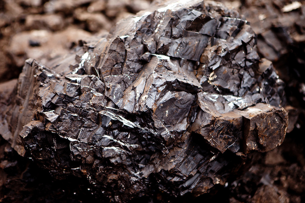 """A piece of coal at the North Bohemian Brown Coal Basin during a so called """"Czech Coal Safari"""" in Most area. The Czech Coal Group offers visitors the possibilty to see unique technical works in the mining areas of their surface mines."""