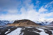 Dwellings and volcanic moraine under Eyjafjallajokull glacier famous for major volcanic eruption, Katla Geopark in South Iceland