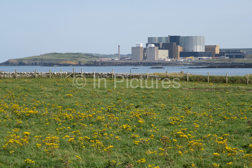 View towards the Wylfa Nuclear Power Station at Llanddausaint on 15th September 2020 from Cemlyn, Anglesey, Wales, United Kingdom. Wylfa Nuclear Power Station is a former Magnox power station situated west of Cemaes Bay on the island of Anglesey, off the northwestern coast of Wales. In 2012, Reactor 2 was shut down. Three years later, Reactor 1 was switched off on 30 December 2015 so ending 44 years of operation at the site.