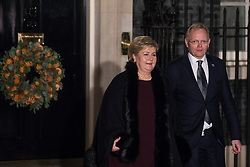 London, UK. 3 December, 2019. Erna Solberg, Prime Minister of Norway, leaves with her husband Sindre Finnes following a reception for NATO leaders at 10 Downing Street on the eve of the military alliance's 70th anniversary summit at a luxury hotel near Watford.