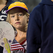 August 16, 2014, New Haven, CT:<br /> A fan holds an American Flag during Military Night on day four of the 2014 Connecticut Open at the Yale University Tennis Center in New Haven, Connecticut Monday, August 18, 2014.<br /> (Photo by Billie Weiss/Connecticut Open)