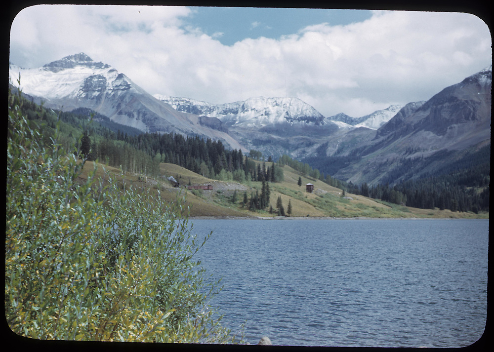 View from near the Trout Lake dam showing the water tank and an approaching northbound RGS freight train in the distance.<br /> RGS  Trout Lake, CO  ca. 1950<br /> Thanks to Don Bergman for additional information.
