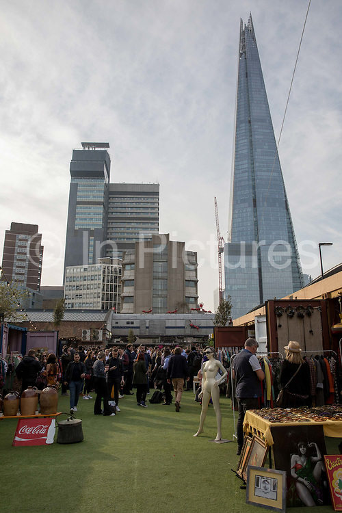 A busy Vinegar Yard the evening before the Easter bank holiday weekend on the 18th April 2019 in London Bridge in the United Kingdom. Vinegar Yard is a pop up street market with street food, art installations and pop-up shops in Bermondsey.