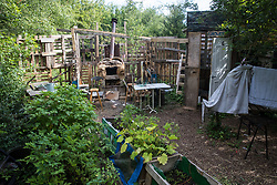 Fruit and vegetables and a home-built pizza oven and shower are seen at the Stop HS2 Wendover Active Resistance Camp on 17th July 2020 in Wendover, United Kingdom. Environmental activists from groups including Stop HS2 and HS2 Rebellion continue to protest against HS2, which is currently projected to cost £106bn and which will remain a net contributor to CO2 emissions during its projected 120-year lifespan, on environmental and economic grounds.