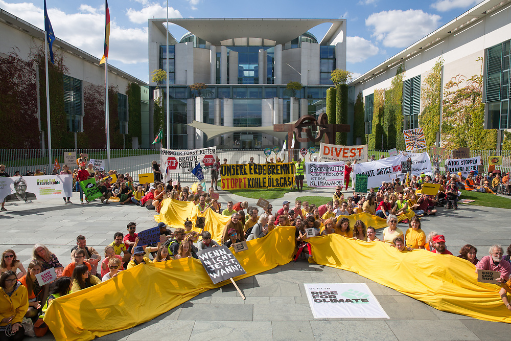 """Berlin, Germany - 08.09.2018<br /> <br /> Climate protection protest rally in front of the Federal Chancellery as part of the international """"Rise for climate"""" action day.<br /> <br /> Klimaschutzprotest-Kundgebung vor dem Bundeskanzleramt im Rahmen des internationalen """"Rise for climate""""-Aktionstags.<br />   <br /> Photo: Bjoern Kietzmann"""