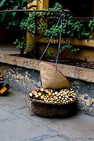 a traditional conical hat sits on a basket of produce inside the quan su temple in hanoi