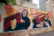 Egypt, Cairo. January 2014. Armenian Catholic Church on the corner of Mohammed Sabry Abo Alam Street and Youssef El Guindy Street.  Grafitti commemorating revolution and martyrs. Image of mother holding portrait of her dead son, next to body in a coffin.