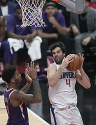 December 20, 2017 - Los Angeles, California, U.S - Milos Teodosic #4 of the Los Angeles Clippers rebounds during their NBA game with the Phoenix Suns on Wednesday December 20, 2017 at the Staples Center in Los Angeles, California. Clippers vs Suns. (Credit Image: © Prensa Internacional via ZUMA Wire)