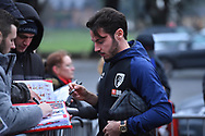 Adam Smith (15) of AFC Bournemouth signs his autograph for a fan on arrival at the Vitality Stadium before the Premier League match between Bournemouth and West Ham United at the Vitality Stadium, Bournemouth, England on 19 January 2019.