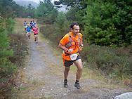 Kerhonkson, New York - Ted Listokin runs through Minnewaska State Park Preserve during the Shawangunk Ridge Trail Run/Hike 20-mile race on Sept. 20, 2014.
