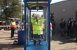 South Africa - Pretoria - 12 May 2020 - Gauteng transport MEC Jacob Mamabolo steps trough a sanitizing station at Mabopane taxi rank during a visit to ensure that lockdown regulations are being followed.<br /> Picture: Jacques Naude/African News Agency(ANA)