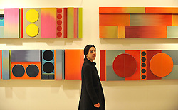 © under license to London News Pictures. LONDON, UK  05/05/2011. A gallery worker stands in front of Ptolemy Mann and Lubna Chowdhary's 'The Chromatic Landscape'. The unveiling today (5 May 2011) of Tracey Emin's first tapestry ahead of the launch of COLLECT, the Crafts Council's international craft fair for contemporary objects at the Saatchi Gallery, London. Photo credit should read Stephen Simpson/LNP.