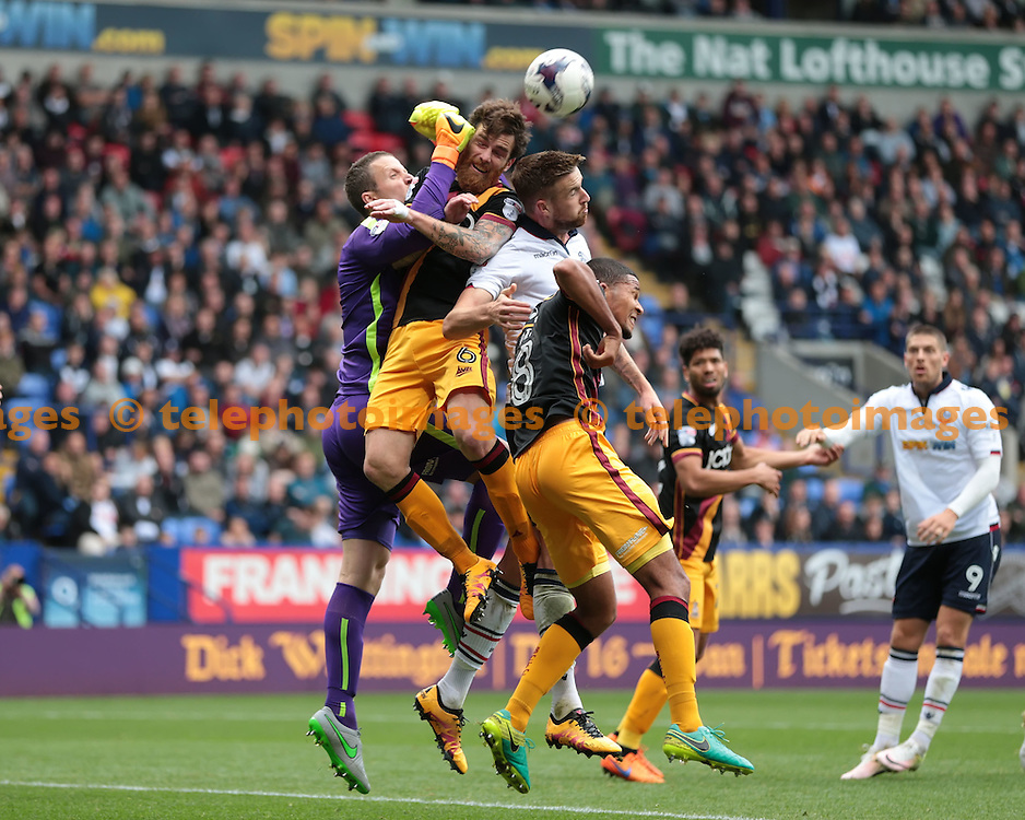 Bradford City goalkeeper Colin Doyle (1) punches clear during the Sky Bet League 1 match between Bolton Wanderers and Bradford City at the Macron Stadium in Bolton. September 24, 2016.<br /> Nigel Pitts-Drake / Telephoto Images<br /> +44 7967 642437