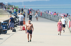 ©Licensed to London News Pictures 06/08/2020     Minster-on-sea, UK. A man enjoying the heat with his top off. Hot sunny weather today as people visit the beach at Minster-on-sea, Isle of sheppey in Kent. Photo credit: Grant Falvey/LNP