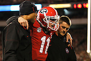 ATHENS, GA - NOVEMBER 23:  Quarterback Aaron Murray #11 of the Georgia Bulldogs is escorted off of the field by members of his coaching staff after getting injured during the game against the Kentucky Wildcats at Sanford Stadium on November 23, 2013 in Athens, Georgia.  (Photo by Mike Zarrilli/Getty Images)