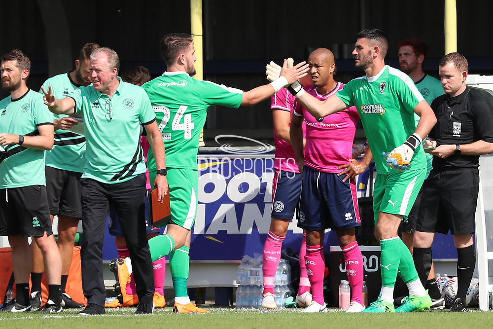 AFC Wimbledon goalkeeper Tom King (1) coming on for AFC Wimbledon goalkeeper Joe McDonnell (24) during the Pre-Season Friendly match between AFC Wimbledon and Queens Park Rangers at the Cherry Red Records Stadium, Kingston, England on 14 July 2018. Picture by Matthew Redman.