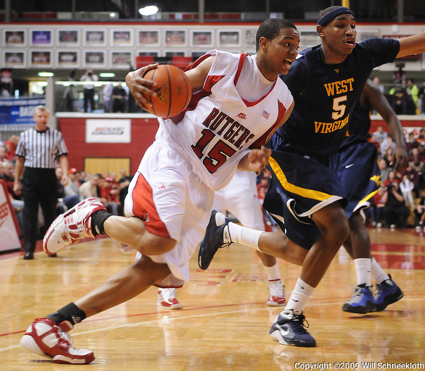 Feb 22, 2009; Piscataway, NJ, USA; Rutgers forward J.R. Inman (15) drives to the basket against West Virginia forward Kevin Jones (5) during the first half of Rutgers' 74-56 loss to West Virginia at the Louis Brown Athletic Center.