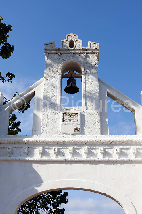 The bell tower at the entrance to the Roca Bello Monte, a restored Colonial plantation, Principe, Sao Tome and Principe<br /> Sao Tome and Principe, are two islands of volcanic origin lying off the coast of Africa. Settled by Portuguese convicts in the late 1400s and a centre for slaving, their independence movement culminated in a peaceful transition to self government from Portugal in 1975.