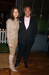 DAVID TANG and his wife LUCY at a party to celebrate the publication of 'E is for Eating' by Tom Parker Bowles held at Kensington Place, 201 Kensington Church Street, London W8 on 3rd November 2004.<br /><br />NON EXCLUSIVE - WORLD RIGHTS