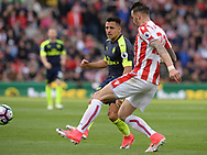 Alexis Sanchez of Arsenal battles with Geoff Cameron of Stoke. Premier league match, Stoke City v Arsenal at the Bet365 Stadium in Stoke on Trent, Staffs on Saturday 13th May 2017.<br /> pic by Bradley Collyer, Andrew Orchard sports photography.