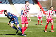 Luke Prosser of Stevenage gets ready to header the ball  during the EFL Sky Bet League 2 match between Stevenage and Bradford City at the Lamex Stadium, Stevenage, England on 5 April 2021.
