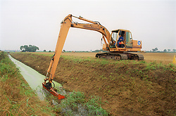 Maintenance work on a drain at Lade Bank near Boston; Lincolnshire; using a hydraulic excavator with weed cutting basket,
